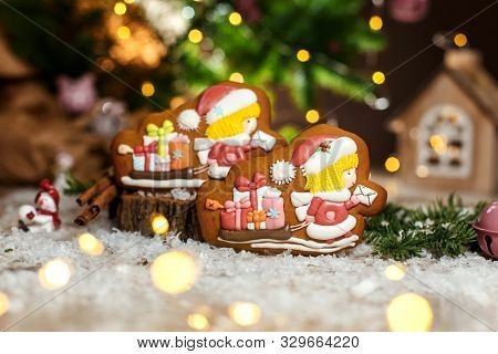 Holiday Traditional Food Bakery. Gingerbread Two Chirstmas Postman And Sleigh With Gifts In Cozy War