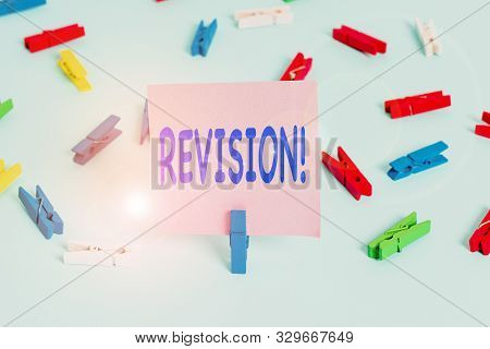 Text sign showing Revision. Conceptual photo action of revising over someone like auditing or accounting Colored clothespin papers empty reminder blue floor background office pin. poster