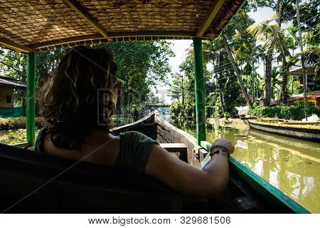 Alleppey - Alappuzha, India - 13 November 2017: Tourist Girl Sitting In Boat During Tour Through The