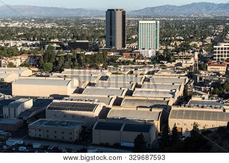Burbank, California, USA - October 20, 2019:  Morning view of historic Warner Bros studio sound stages and Burbank Media District buildings in the San Fernando Valley.