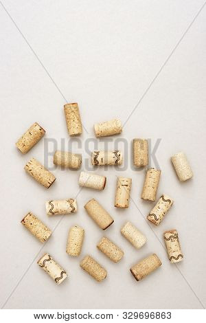 Minimal Trendy Concept With Corks From Wine Bottles On Lignt Paper Background With Copy Space. Flat