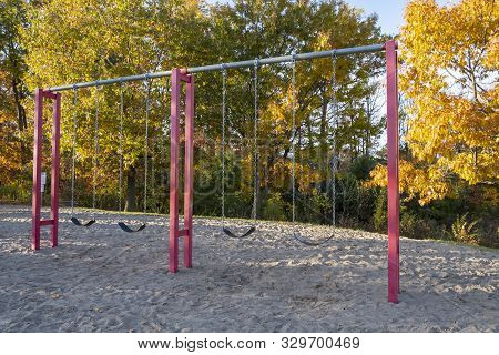 Swings In A Playground On A Beautiful Fall Afternoon