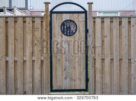 New Wooden Fence And Backdoor Of A House