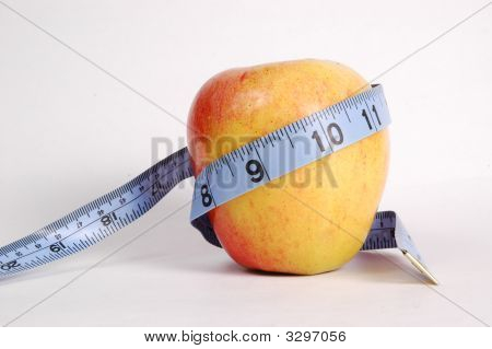 Apple Wrapped In Blue Tape Measure