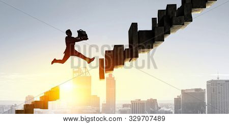 Businessman jump over leap. Mixed media