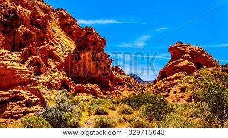 The Erratic Red Aztec Sandstone Formation Near The Arch Rock Campground Under Clear Blue Sky In The