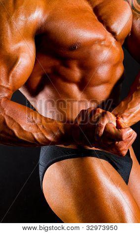 male bodybuilder's body on black background