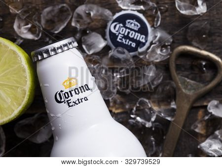 London, Uk - April 27, 2018: Steel Bottle Of Corona Extra Beer On Wooden Background With Bottle Open