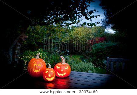 Three carved Halloween pumpkins