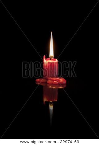 Red Melted Candle With Flame