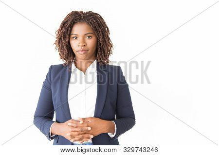 Serious Confident Professional Posing With Clasped Hands. Young African American Business Woman Stan