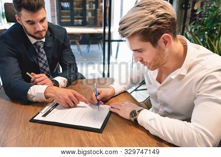 Man Signs Agreement Contract At The Office. Business Contract, Legal Agreement Concept
