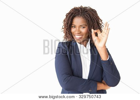 Satisfied Happy Customer Making Ok Gesture. Young Black Business Woman Standing Isolated Over Studio