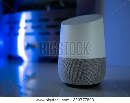 smart home speaker assistant on fireplace with led coloured ambient lighting - Deep Blue poster