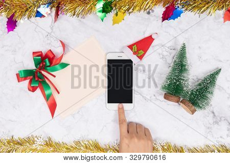 Online Shopping On Seasonal Gifts During Christmas Holiday. Woman Touch Mobile Phone Button Decorate