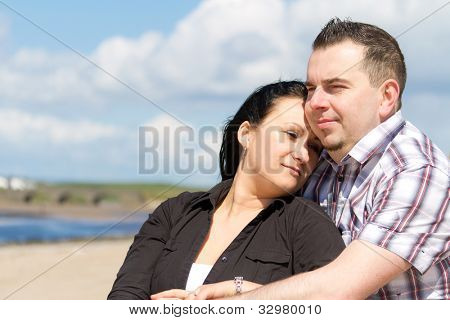 Couple together at relaxation on the beach