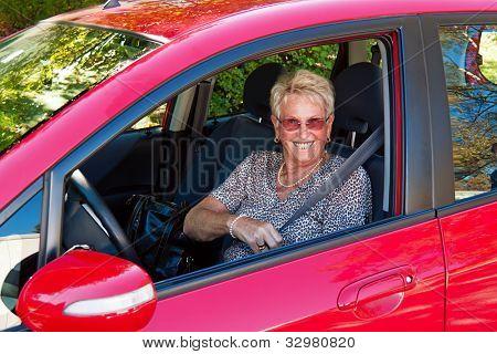 elderly woman in a seat belt in a car.
