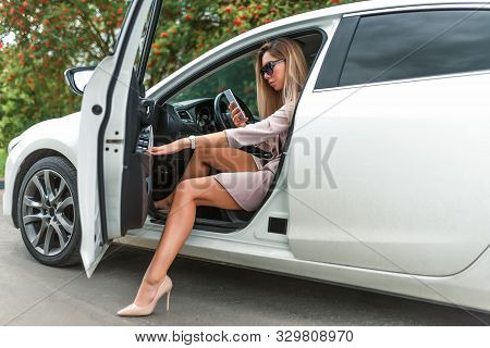 Beautiful Girl Business Lady, Summer Autumn City, Gets Out Car, Getting Car Tanned Leather Shoes. Ca