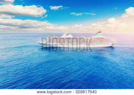 Cruise Liner Floats On Blue Sea. Concept Summer Vacation Tour. Sunny Day