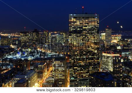 Boston John Hancock Tower and Back Bay Skyline at night, from top of Prudential Center, Boston, Massachusetts, USA.