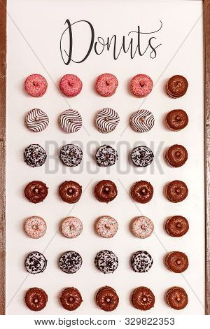 Wedding Chocolate Donuts For Guests. Festive Concept. Sweets On A Wedding Day. Wedding Donuts. A Yum
