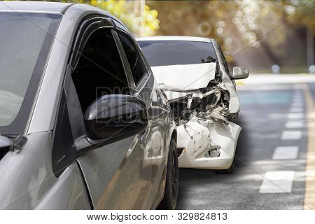 Front Of White Color Car Crash With Back Side Of Gray Color Car Damaged And Broken By Accident On Ro