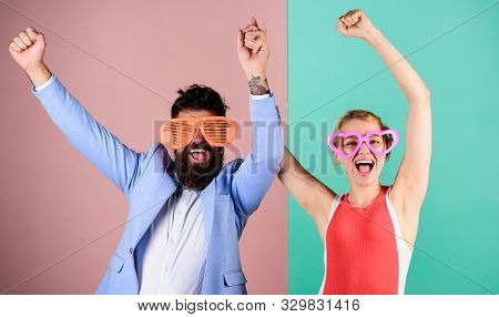 Bearded Man Pretty Woman Party Goggles Celebrating. Couple Having Fun. Office Party. Corporate Cultu