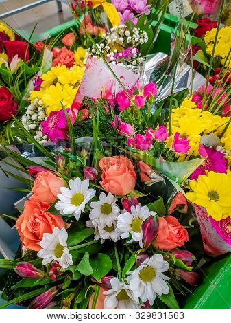 Bouquets Of Flowers In The Supermarket . Ready-made Bouquets. Flowers On The Occasion. Beautiful Bri