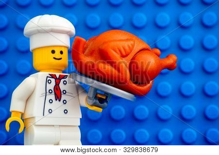 Tambov, Russian Federation - October 19, 2019 Lego Chef Minifigure With Turkey Against Blue Baseplat