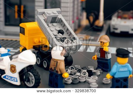 Tambov, Russian Federation - October 21, 2019 Lego Dump Truck Dumping Out Load Onto Road Due To Road