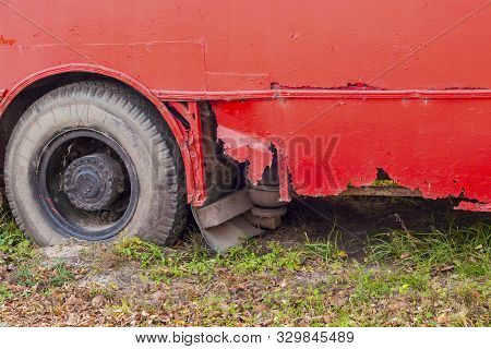 The Rusty, Leaky Bottom Of The Vehicle, Painted Over With Red Paint