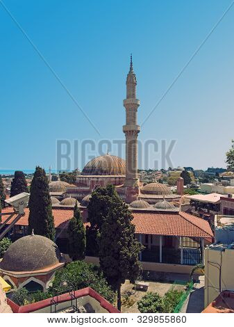A Panoramic View Of Rhodes Town With The Dome And Minaret Of The Suleiman Mosque And City Buildings