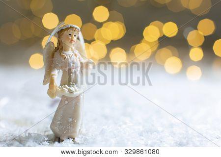 Decorative Christmas-themed Figurines. Statuette Of A Christmas Angel. Christmas Tree Decoration. Fe