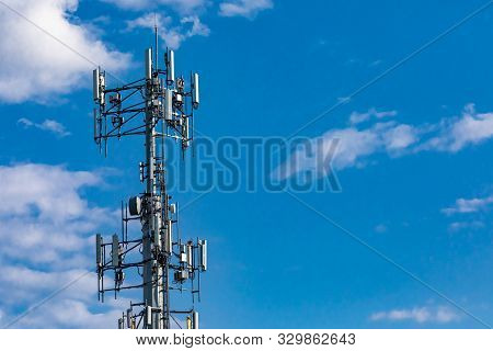 A Low Angle View Of A Typical Cell Network Antenna Tower. Used To Send And Receive Mobile Network Co