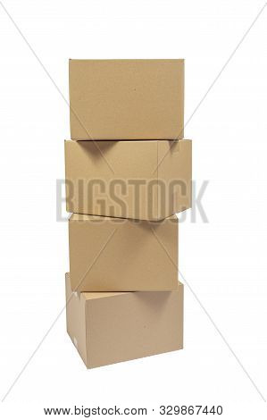 Vertical Shot Of Four Stacked Cardboard Boxes Isolated On White.