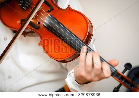 Violin Playing Viola Musician Playing . Man Violinist Classical Musical Instrument  Fiddle .