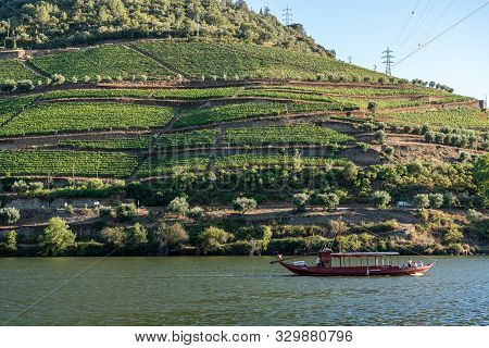 Pinhao, Portugal - 13 August 2019: Tourists On Rabelo Tour Boat On River In Douro Valley Near Pinhao
