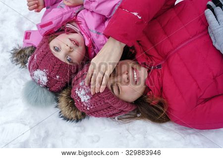 Fashionable Stylish Family Having Fun Playing In Snow. Weekends Activities Outdoor In Cold Weather.