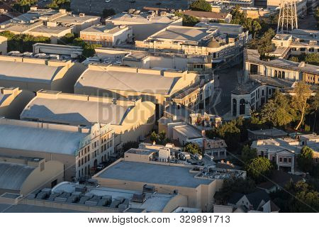 Burbank, California, USA - October 25, 2019:  Morning aerial view of sound stages and back lot buildings at the Warner Bros studio lot near Los Angeles.