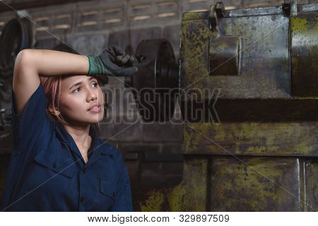 Young Female Asian Engineer Exhausted With Overtime Workload Working In Industrial Factory