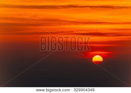 Beautiful Blazing Sunset Landscape And Orange Sky Above It. Amazing Summer Sunrise As A Background.