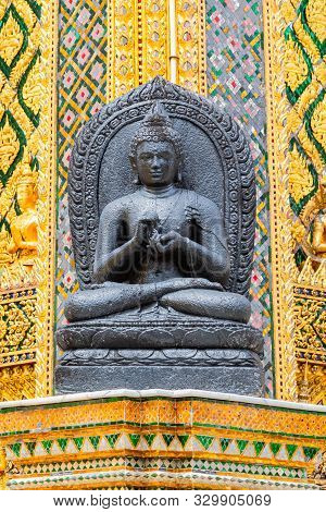 A Black Buhhda Statue Adorns One Of The Buildings In The Wat Phra Kaew Complex.