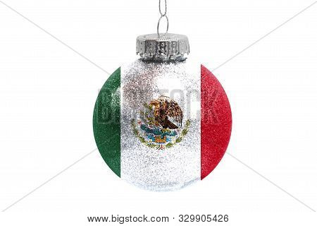 Glass Christmas Ball Toy Isolated On White Background With The Flag Of Mexico