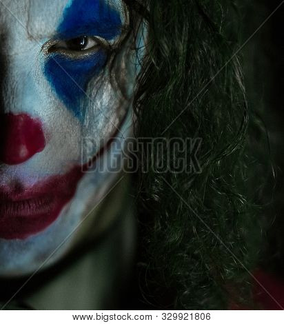 Dnipro, Ukraine - October 22, 2019: Portrait Of Half Face Of Cosplayer In The Image Of A Crazy Clown