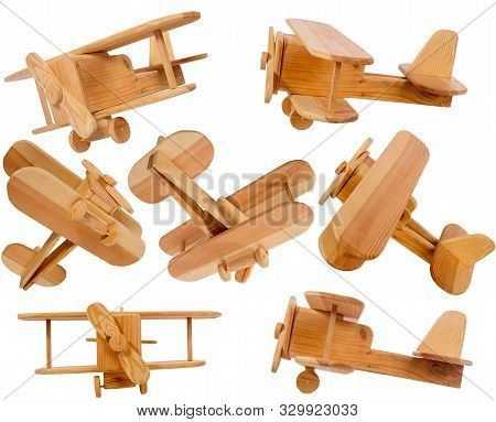 Wooden Homemade Biplane Airplane In Different Projections Isolated On A White Background