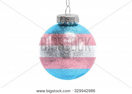 Glass Christmas Ball Toy Isolated On White Background With The Flag Of Transgender