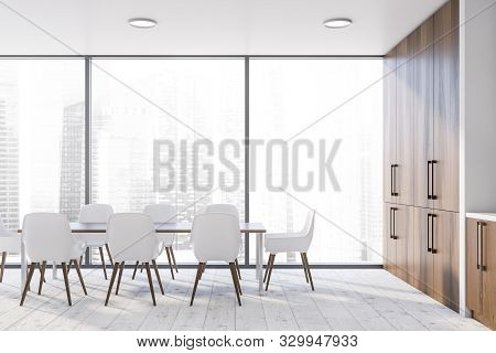 Interior of stylish dining room with white walls, panoramic window with cityscape, long wooden table with white chairs and dark wooden cupboards. 3d rendering poster