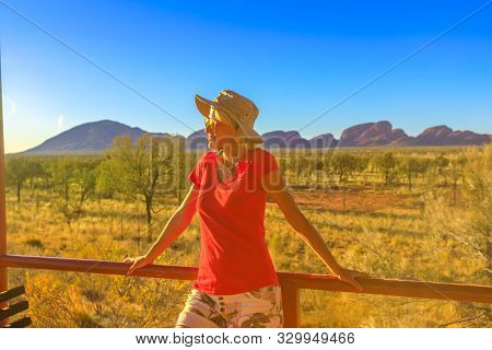 Uluru, Northern Territory, Australia - Aug 24, 2019: Tourism In Australia. Tourist Woman Looks Mount