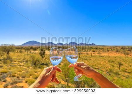 Uluru, Northern Territory, Australia - Aug 25, 2019: Toast With Two Glasses In Kata Tjuta Or The Olg