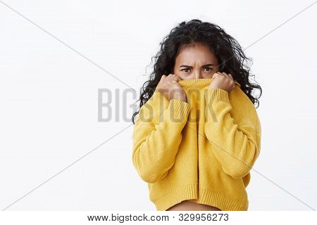 Gloomy Sulking Girl Stare Pressured And Angry, Pull Sweater On Nose And Frowning Offended, Standing